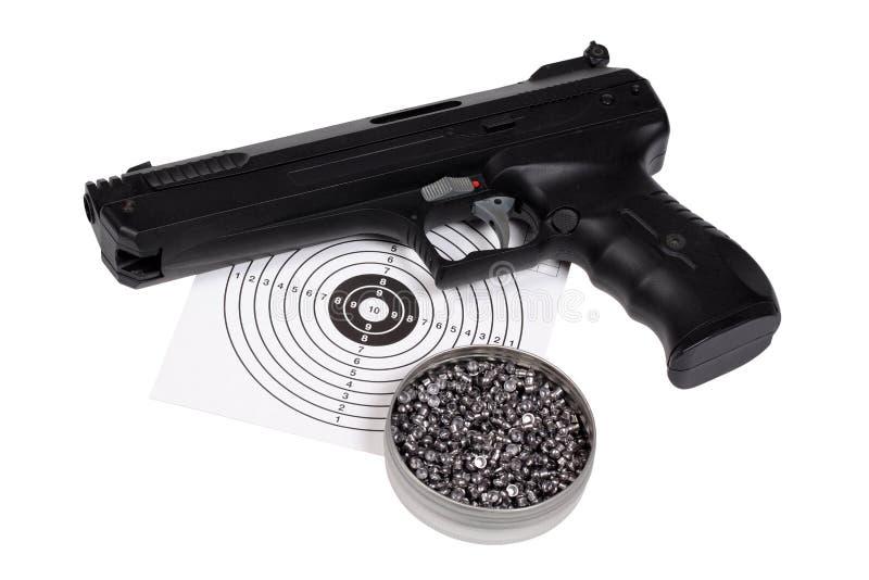 Pistola pneumática com arma-protetor e pelotas na caixa imagem de stock royalty free