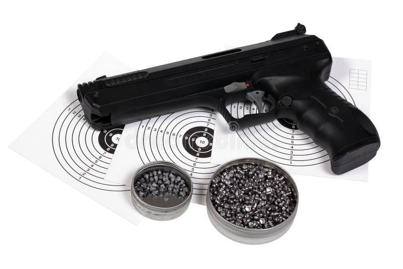 Pistola pneumática com arma-protetor e pelotas na caixa fotografia de stock