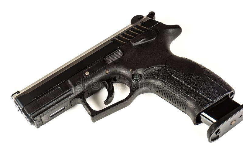 A pistola preta da arma em um fim branco do fundo acima foto de stock royalty free