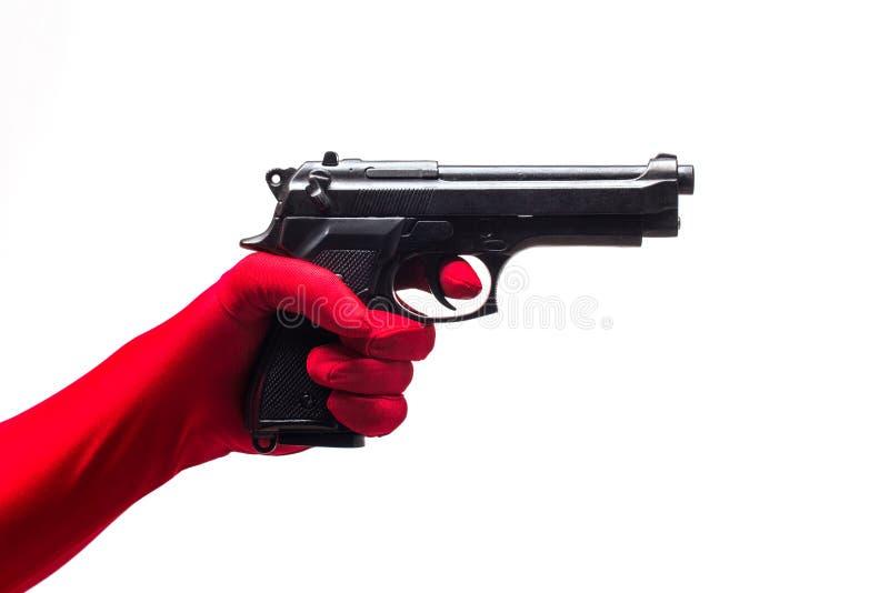 Pistola rossa della tenuta della mano, isolata su bianco immagini stock