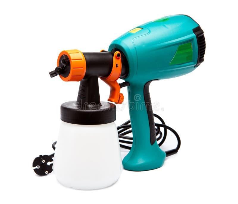 Pistola a spruzzo elettrica per colorazione, per polverizzazione di colore. Chiuda su in un giorno soleggiato immagini stock