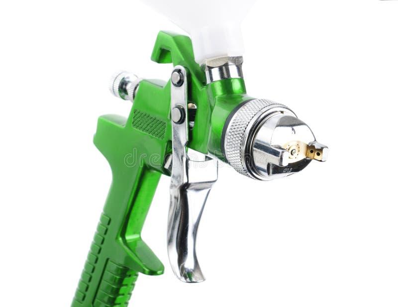 Pistola a spruzzo isolata sopra bianco fotografia stock libera da diritti
