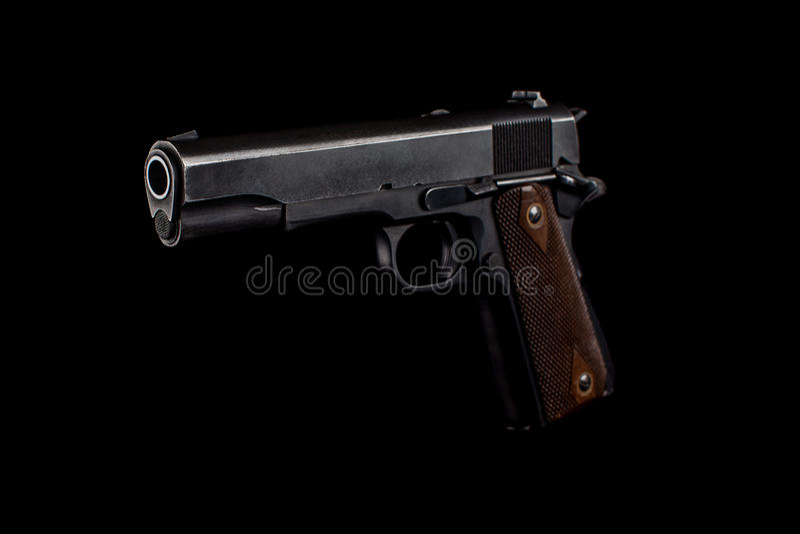 Pistola 1911 sul nero fotografie stock
