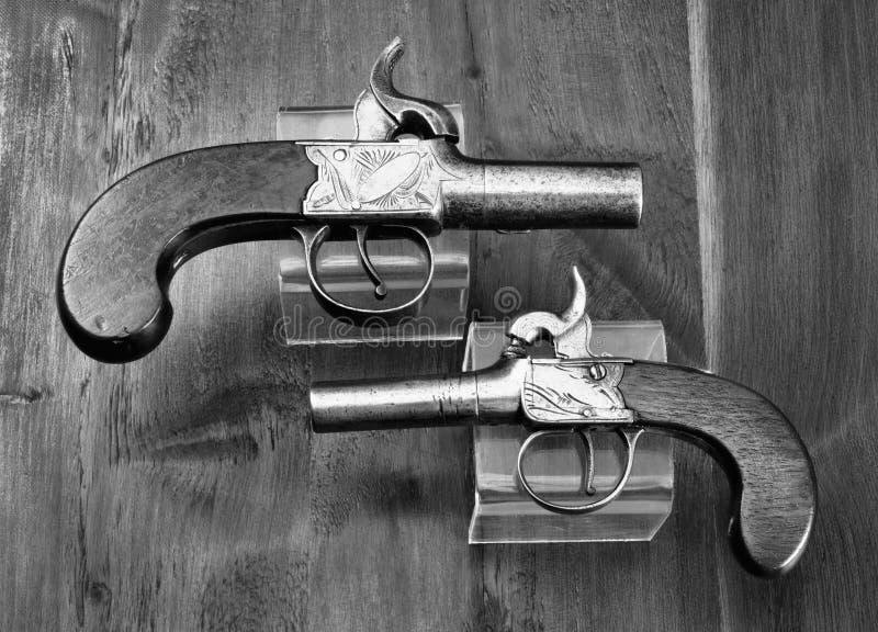 Pistolas inglesas antiguas del manguito de Percision imagen de archivo libre de regalías