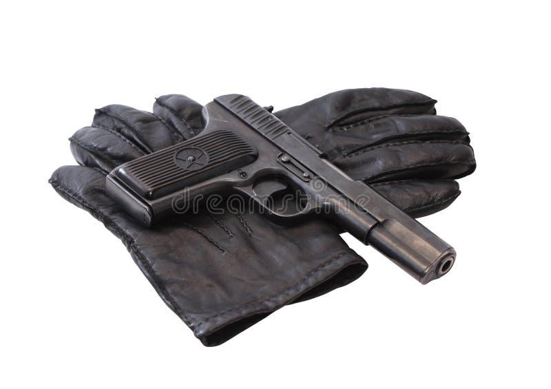 Pistole auf Handschuhen stockbild