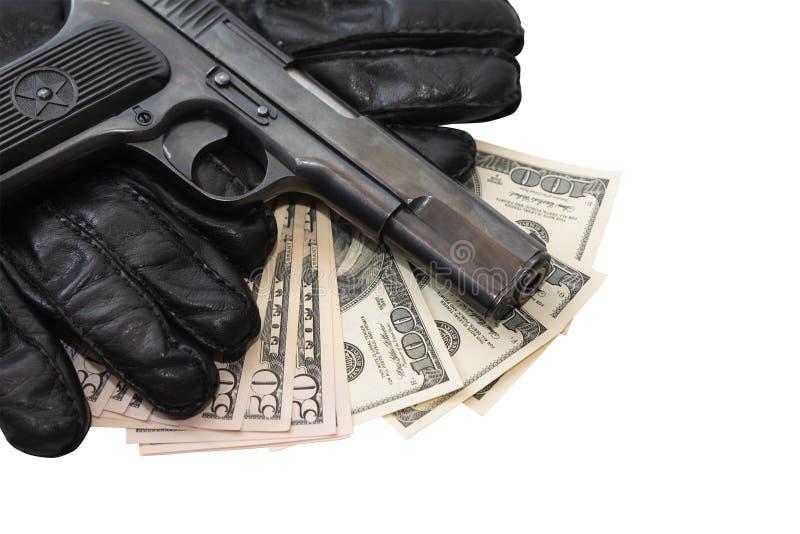 Pistole auf Handschuhen und Geld lizenzfreies stockfoto