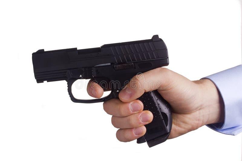 Pistole in der Hand lizenzfreie stockbilder