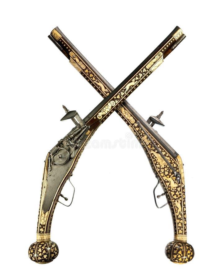 Pistolen passen ursprüngliche antike wheelock und Feuersteinpistolen zusammen stockbild