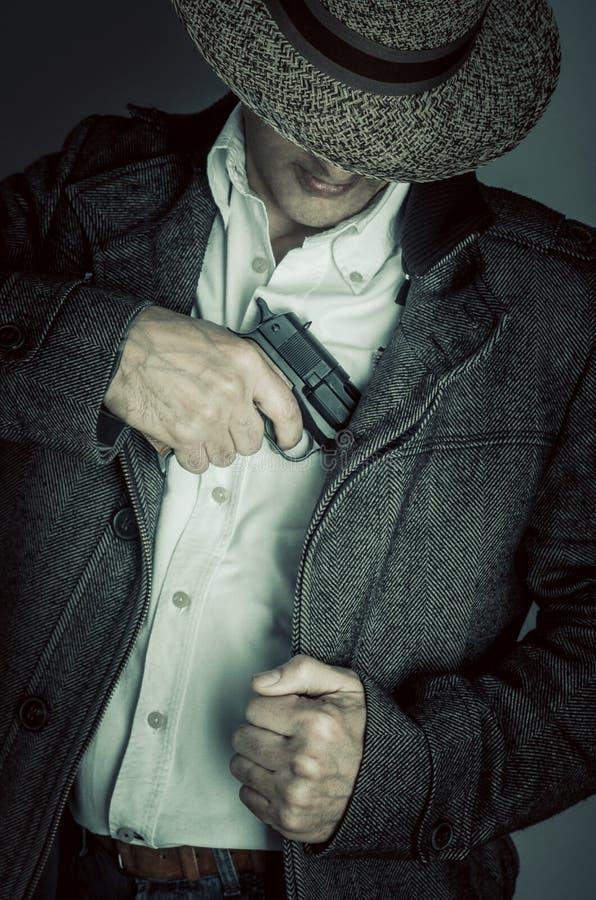 Pistolero con el sombrero fotos de archivo libres de regalías