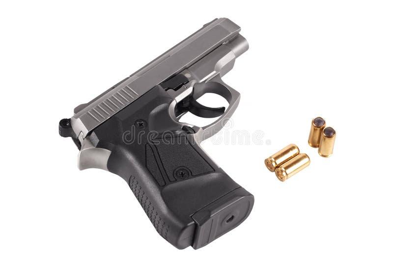 Pistolet avec les munitions traumatiques photographie stock libre de droits