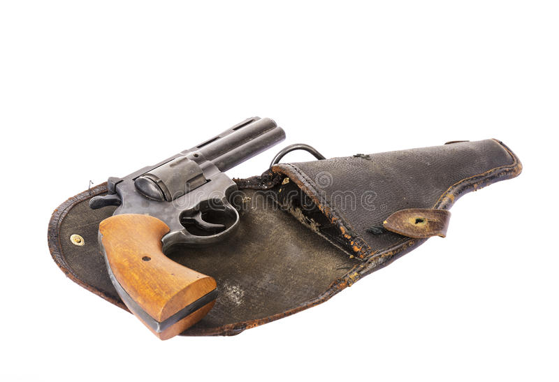 Pistolet de vintage sur un étui d'isolement sur le blanc photo stock