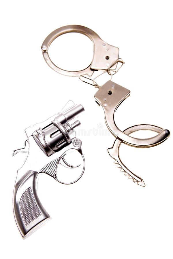 Pistolet et menottes images libres de droits