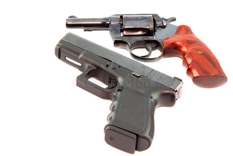 Pistolet semi automatique et canon de revolver images stock