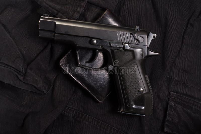 Pistoletowy i rzemienny portfel Portfle i pistolet obraz royalty free