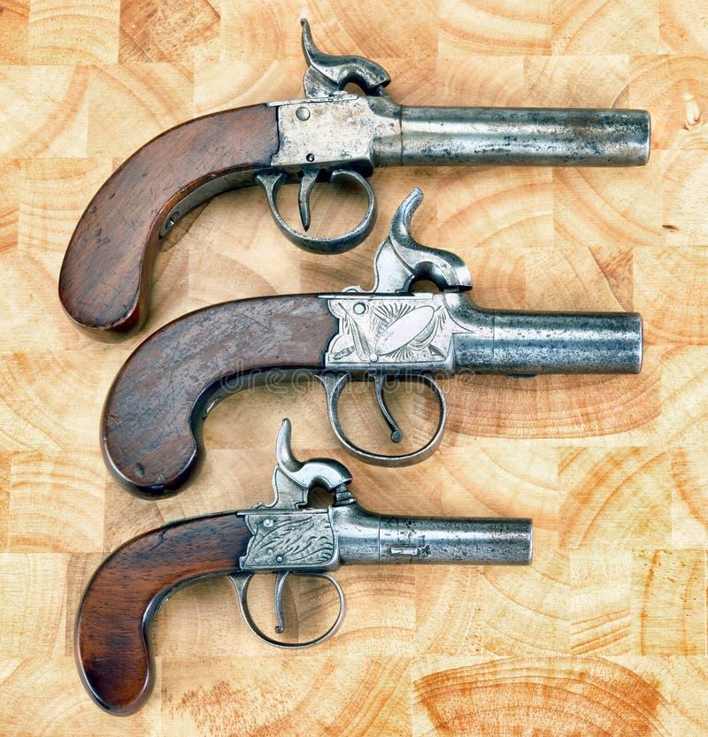 Pistolets antiques de manchon photo stock