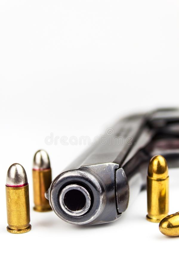 Pistols and hubs on a white background. Defense concept. Detail of the weapon. Right to bear arms. stock image