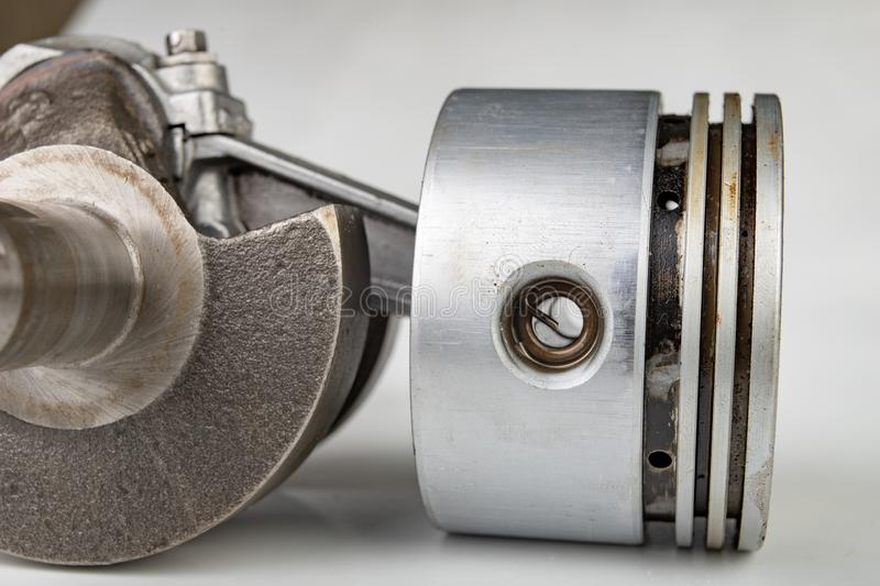 Piston and connecting rod of a small combustion engine. Components needed for mounting a high-power generator stock photography
