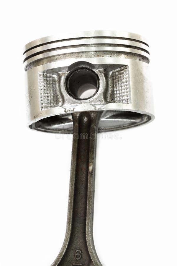 Piston de moteur simple, d'isolement sur le fond blanc photo stock