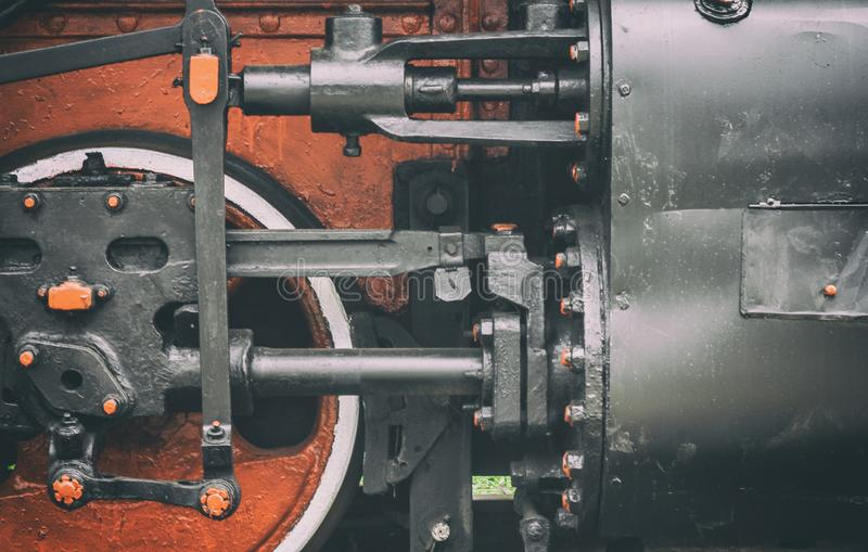 Pistons and driving wheel of the historic steam locomotive. royalty free stock image