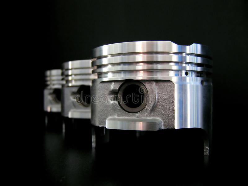 Pistons Isolated On Black Free Stock Photo