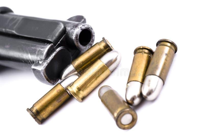 Pistool en kogels stock fotografie