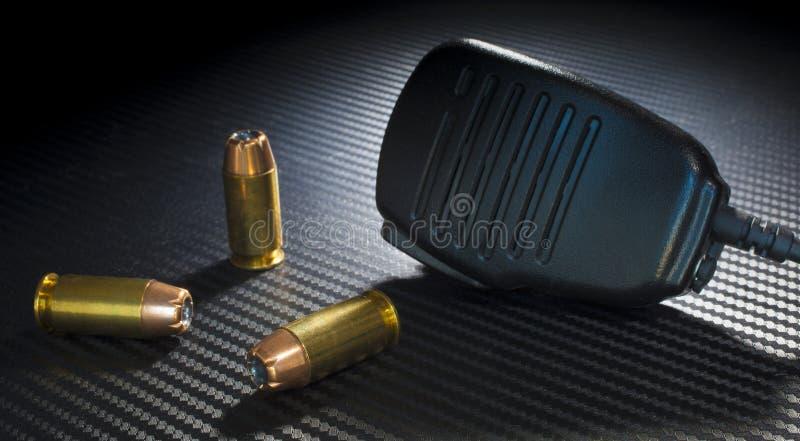Pistool munitie en microfoon royalty-vrije stock foto's