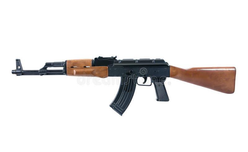 Pistoolwapen - het stuk speelgoed van het misdaadkanon dat op wit wordt ge?soleerd Ge?soleerde het stuk speelgoed van het geweerk royalty-vrije stock fotografie