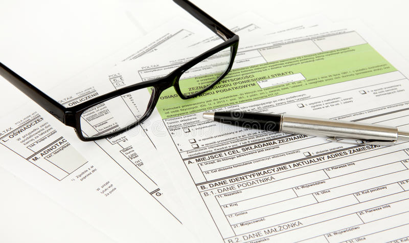 PIT declaration - Polish tax document. Pit 36, pit 37, pen and glasses stock image