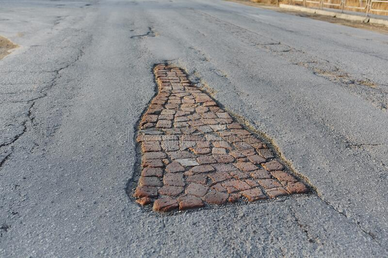 Pit road, laid old brick. Life hack.  stock photos