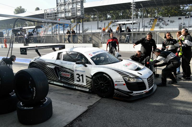 Pit Stop. Monza, final round of the Italian GT Championship 2012. At the Audi box the R8 driven by Dindo Capello is serviced by the mechanics trying to recover royalty free stock images
