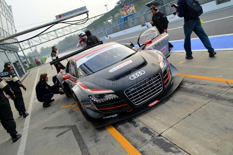Pit Stop. Monza, final round of the Italian GT Championship 2013. At the Audi box the R8 driven by Dindo Capello is serviced by the mechanics trying to recover royalty free stock photos
