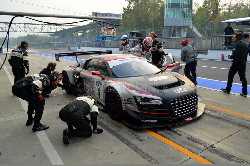 Pit Stop. Monza, final round of the Italian GT Championship 2013. At the Audi box the R8 driven by Dindo Capello is serviced by the mechanics trying to recover royalty free stock images
