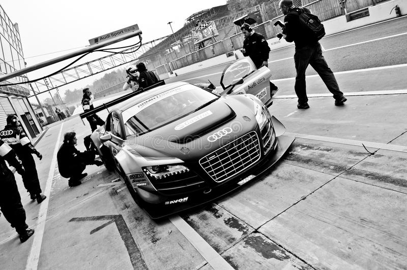 Pit Stop. Monza, final round of the Italian GT Championship 2013. At the Audi box the R8 driven by Dindo Capello is serviced by the mechanics trying to recover stock photography