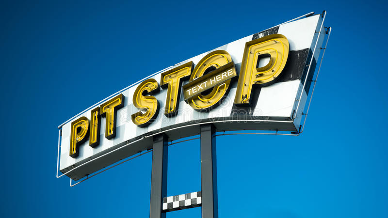 Pit stop sign and text. A large pit stop sign with the blue sky in the background. There is an option to add a text to be part of the image royalty free stock photo