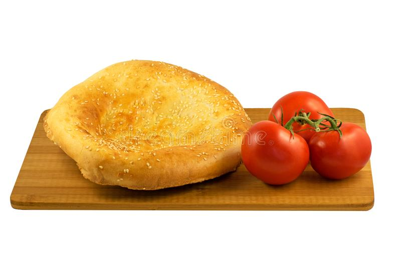 Pita bread and tomatoes on wooden board isolated on white background stock photos