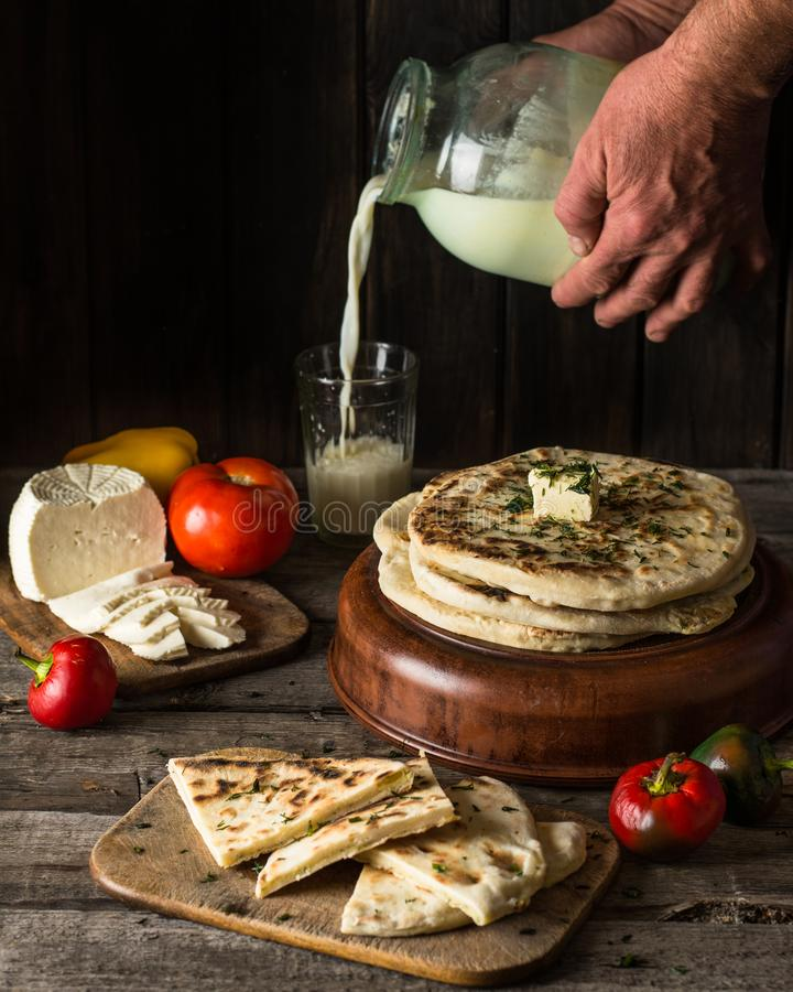 Pita bread on wooden board with feta cheese and tomatoes and pepper. Still life of food. Georgian cuisine. Spanish food. National royalty free stock images