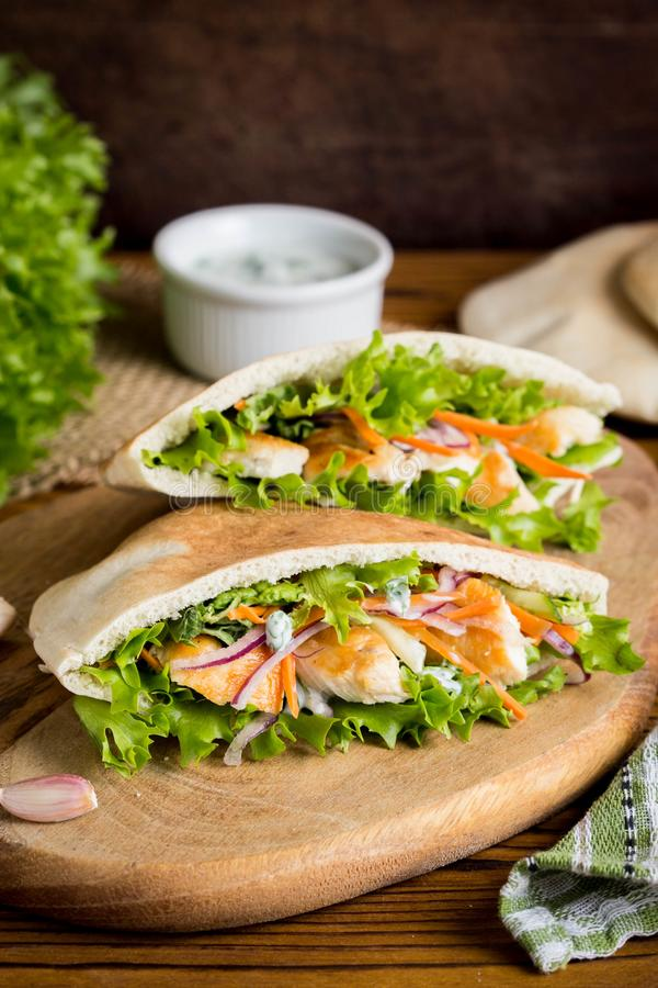Pita with chicken, vegetables and sauce, delicious lunch, fast f royalty free stock photos