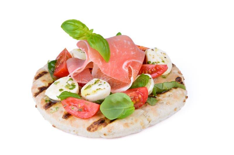 Pita with tomato and mozzarella stock image
