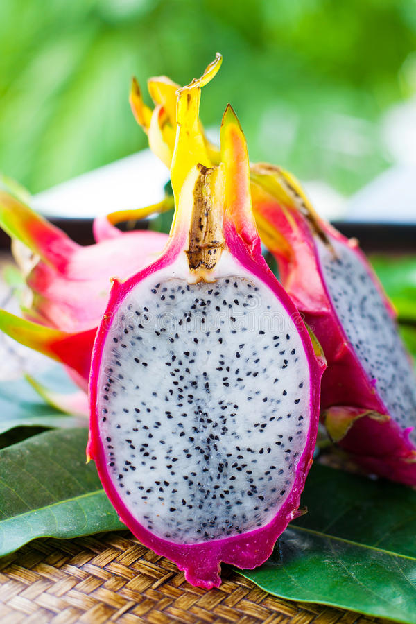 Pitahaya with leaves. On wooden background stock images