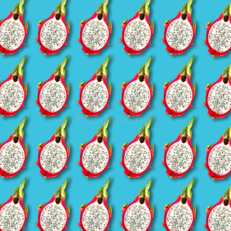 Pitaya fruit slices pattern on vibrant turquoise background stock images