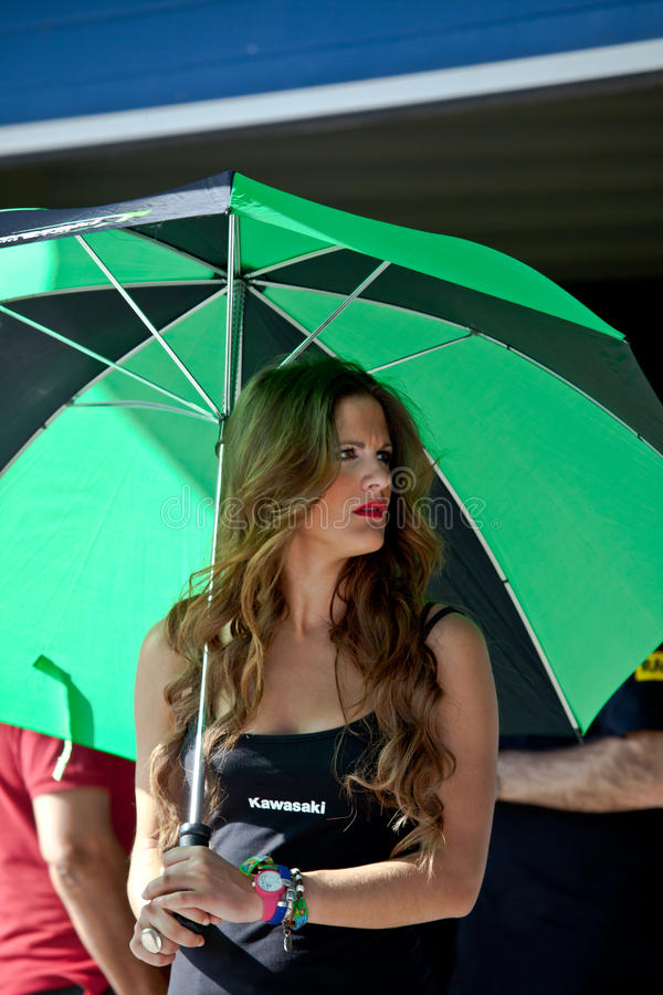 Pitbabe of Kawasaki Ninja Cup of the CEV. JEREZ DE LA FRONTERA, SPAIN - APR 17: Unknown pitbabe of Kawasaki Ninja Cup of the CEV Championship, posing in the royalty free stock photography