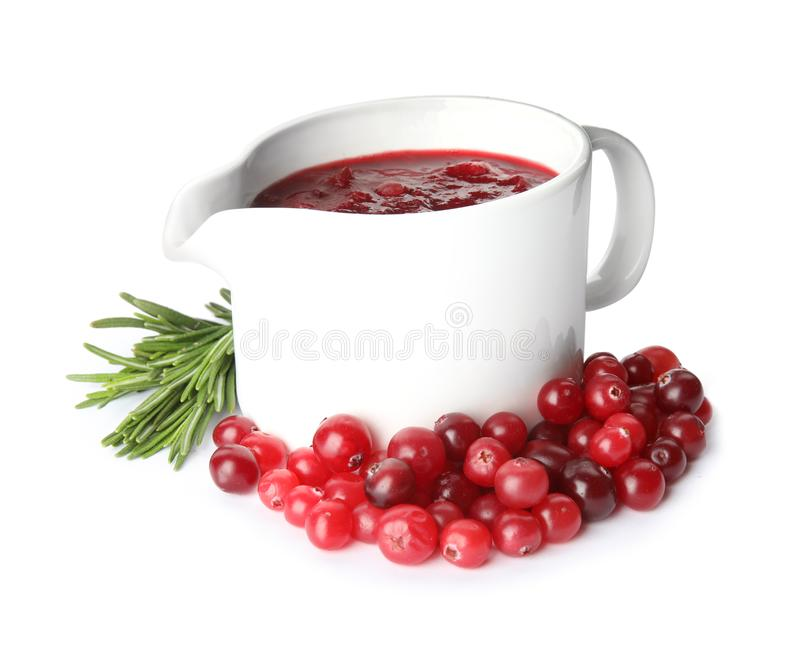 Pitcher of cranberry sauce with rosemary. On white background stock photo