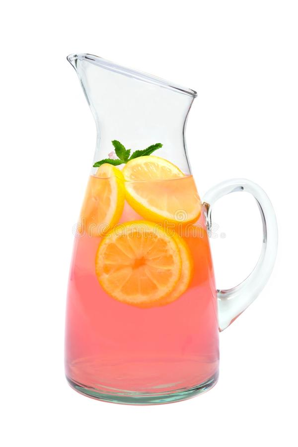 Pitcher of pink lemonade with mint isolated on white stock photo