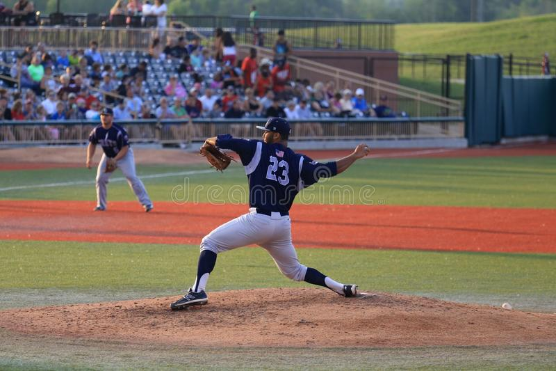 Pitcher throws baseball. Pitcher throws from the mound at the professional baseball game, Baseball Stadium, Lorain County, Ohio, United States royalty free stock images
