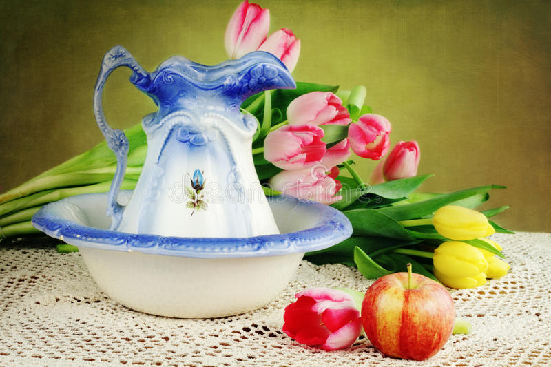 Pitcher and Tulips royalty free stock photography