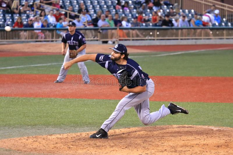 Pitching from the mound. Pitcher throws the curve ball at the professional baseball game, Baseball Stadium, Lorain County, Ohio, United States stock photography