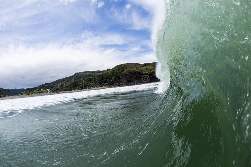 Pitching Wave, South Piha, New Zealand. A large wave in perfect conditions pitches out at Piha Beach, NZ royalty free stock image