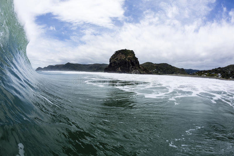 Pitching Wave, South Piha, New Zealand. A large wave in perfect conditions pitches out at Piha Beach, NZ royalty free stock photography