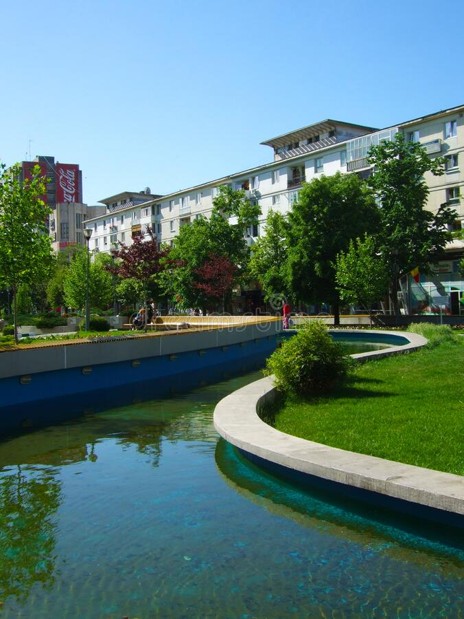 Pitesti city center fountain in Arges region, Romania. A section of the curved water route stock photo