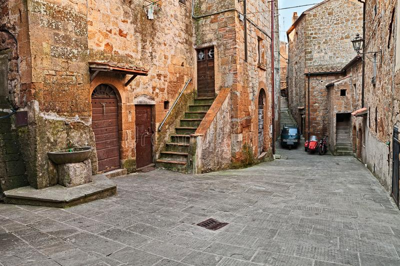 Pitigliano, Grosseto, Tuscany, Italy: old alley in the medieval vill royalty free stock photos